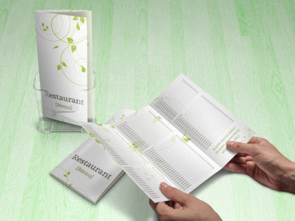 green swirls tri-fold menu holding